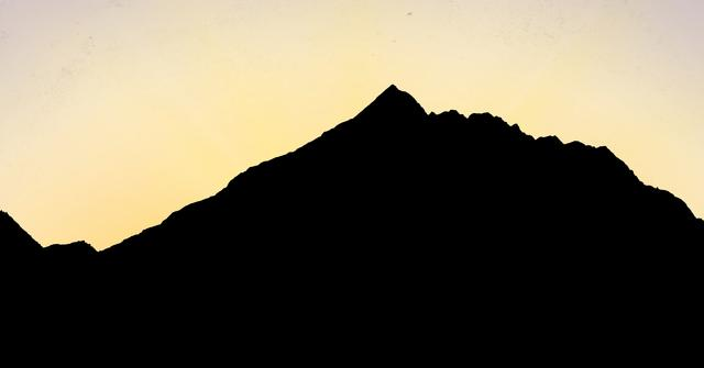Digital composite of Silhouette mountain against sky during sunset