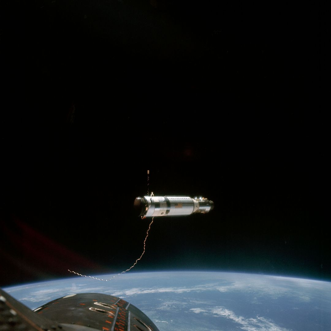S66-54585 (12-15 Sept. 1966) --- The Agena Target Docking Vehicle at a distance of approximately 80 feet from the Gemini-11 spacecraft. This view was taken after the disconnect of the tether between the two vehicles. Crew members for the Gemini-11 mission are astronauts Charles Conrad Jr., command pilot, and Richard F. Gordon Jr., pilot. Photo credit: NASA