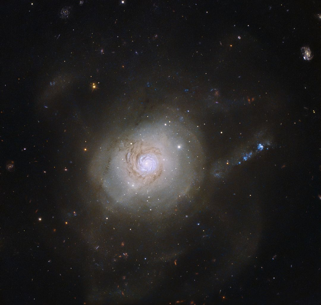 "The spiral galaxy NGC 7252 has a superficial resemblance to an atomic nucleus surrounded by the loops of electronic orbits, and was informally dubbed the &quot;Atoms for Peace&quot; galaxy. These loops are well visible in a wider field of view image.  This nickname is quite ironic, as the galaxy's past was anything but peaceful. Its peculiar appearance is the result of a collision between two galaxies that took place about a billion years ago, which ripped both galaxies apart. The loop-like outer structures, likely made up of dust and stars flung outwards by the crash, but recalling orbiting electrons in an atom, are partly responsible for the galaxy's nickname.  This NASA/ESA Hubble Space Telescope image shows the inner parts of the galaxy, revealing a pinwheel-shaped disk that is rotating in a direction opposite to the rest of the galaxy. This disk resembles a spiral galaxy like our own galaxy, the Milky Way, but is only about 10,000 light-years across — about a tenth of the size of the Milky Way. It is believed that this whirling structure is a remnant of the galactic collision. It will most likely have vanished in a few billion years' time, when NGC 7252 will have completed its merging process.  Image credit: NASA &amp; ESA, Acknowledgements: Judy Schmidt  <b><a href=""http://www.nasa.gov/audience/formedia/features/MP_Photo_Guidelines.html"" rel=""nofollow"">NASA image use policy.</a></b>  <b><a href=""http://www.nasa.gov/centers/goddard/home/index.html"" rel=""nofollow"">NASA Goddard Space Flight Center</a></b> enables NASA's mission through four scientific endeavors: Earth Science, Heliophysics, Solar System Exploration, and Astrophysics. Goddard plays a leading role in NASA's accomplishments by contributing compelling scientific knowledge to advance the Agency's mission.  <b>Follow us on <a href=""http://twitter.com/NASAGoddardPix"" rel=""nofollow"">Twitter</a></b>  <b>Like us on <a href=""http://www.facebook.com/pages/Greenbelt-MD/NASA-Goddard/395013845897?ref=tsd"" rel=""nofollow"">Facebook</a></b>  <b>Find us on <a href=""http://instagrid.me/nasagoddard/?vm=grid"" rel=""nofollow"">Instagram</a></b>"