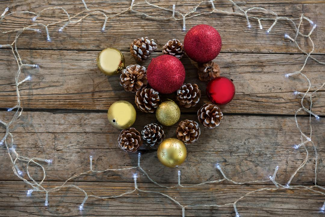 Pine cone and bauble ball decorated with rice light during christmas time