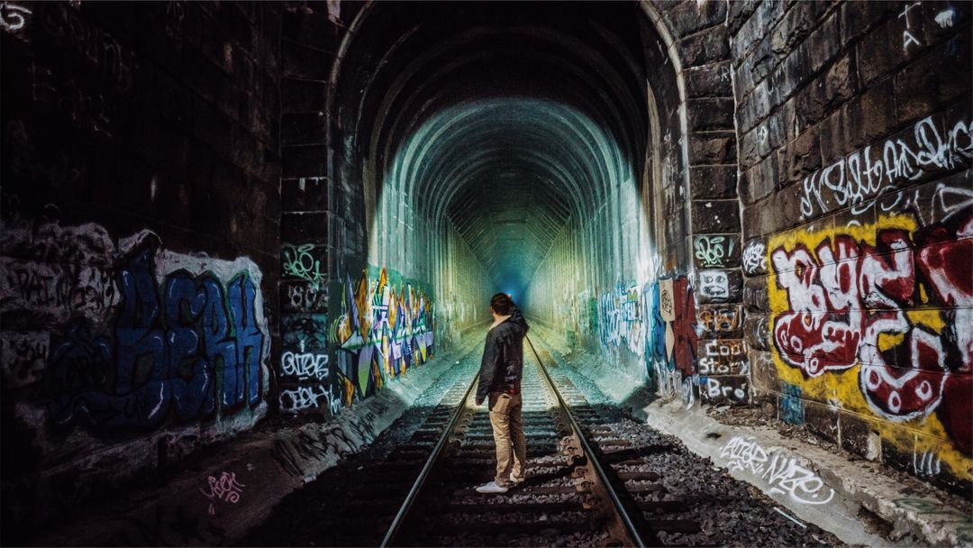 Train tracks tunnel graffiti