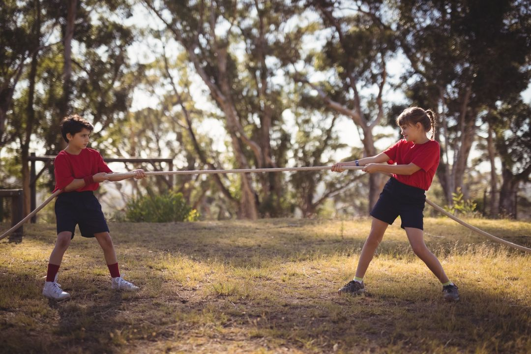 Determined kids practicing tug of war during obstacle course in boot camp Free Stock Images from PikWizard