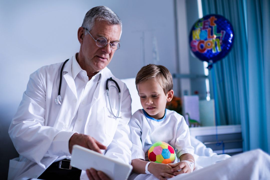 Doctor sitting with child patient showing report
