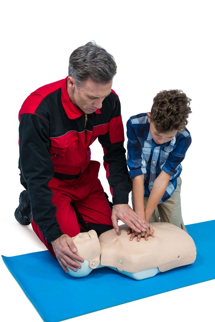 Paramedic training cardiopulmonary resuscitation to boy against white background Free Stock Images from PikWizard