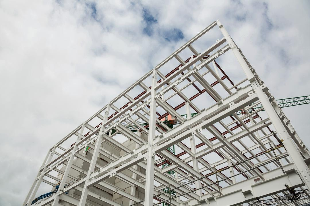 Low angle view of scafolding on building at construction site Free Stock Images from PikWizard