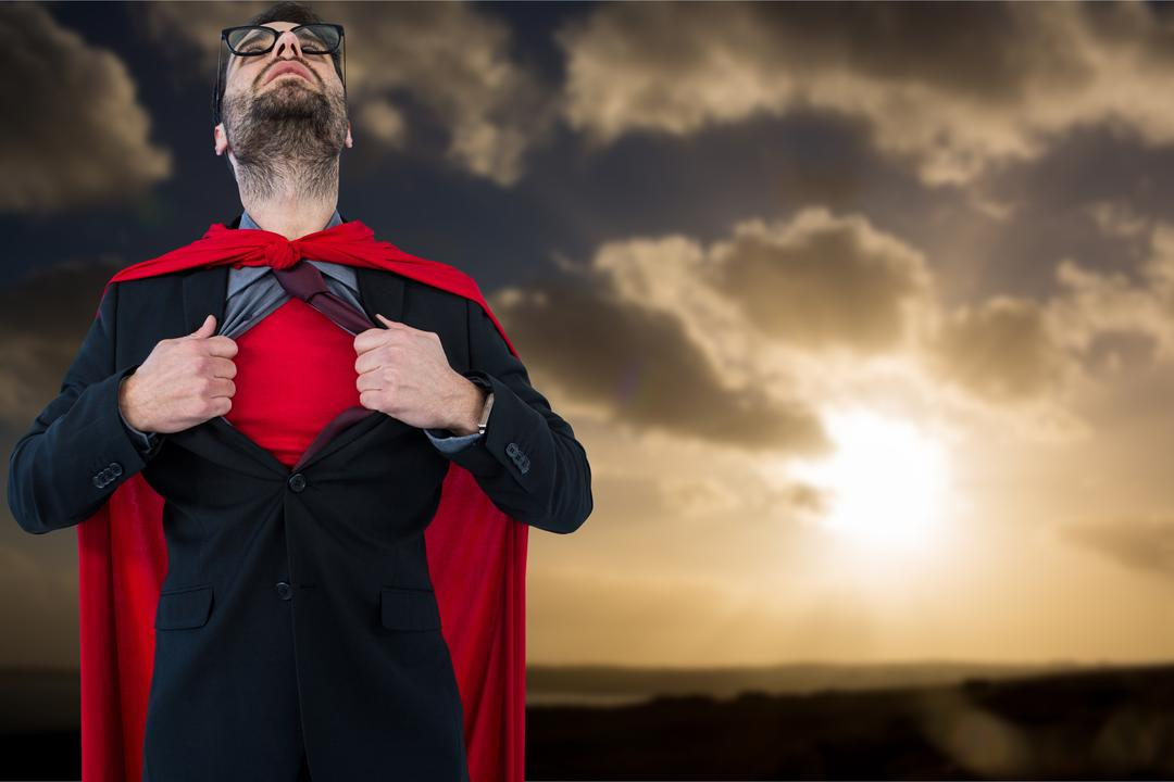 Digital composite of Businessman in super hero costume tearing shirt during sunset Free Stock Images from PikWizard