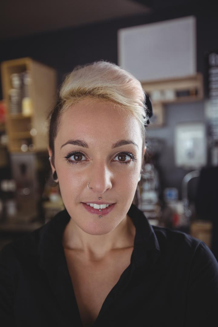 Portrait of smiling waitress in cafe