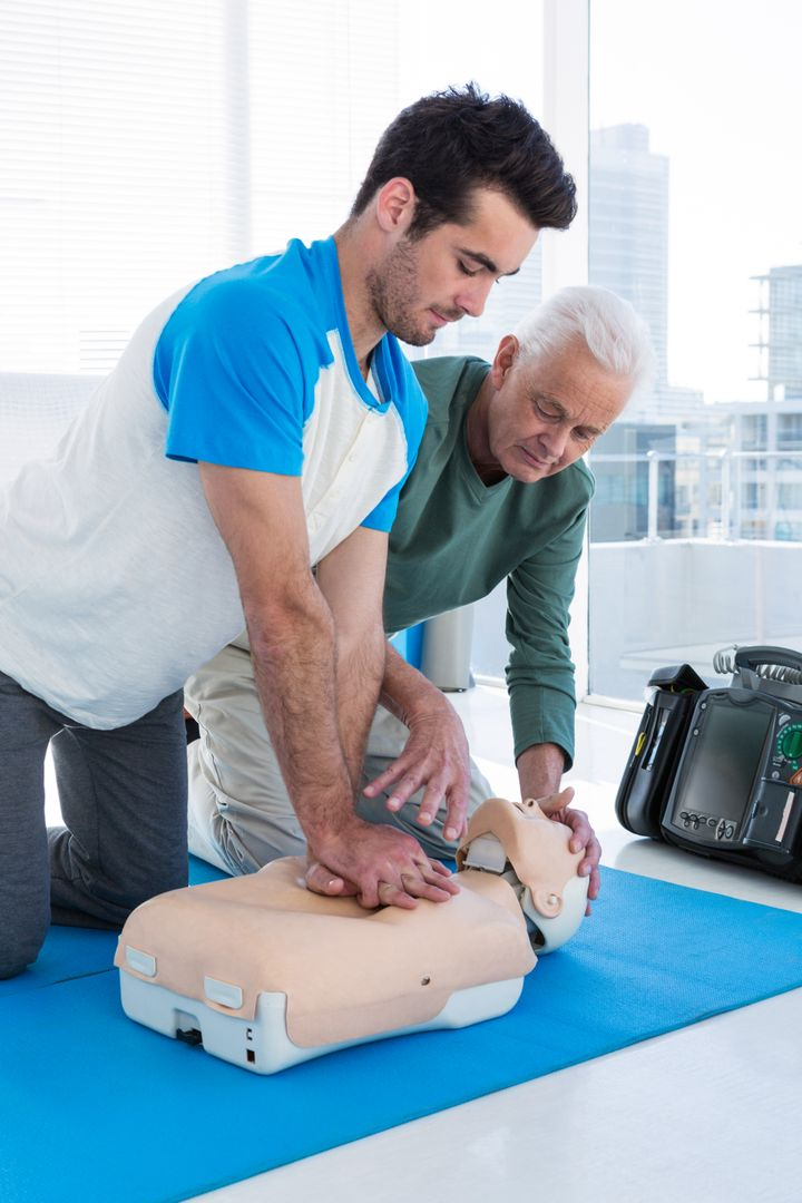 Paramedic training cardiopulmonary resuscitation to man in clinic Free Stock Images from PikWizard