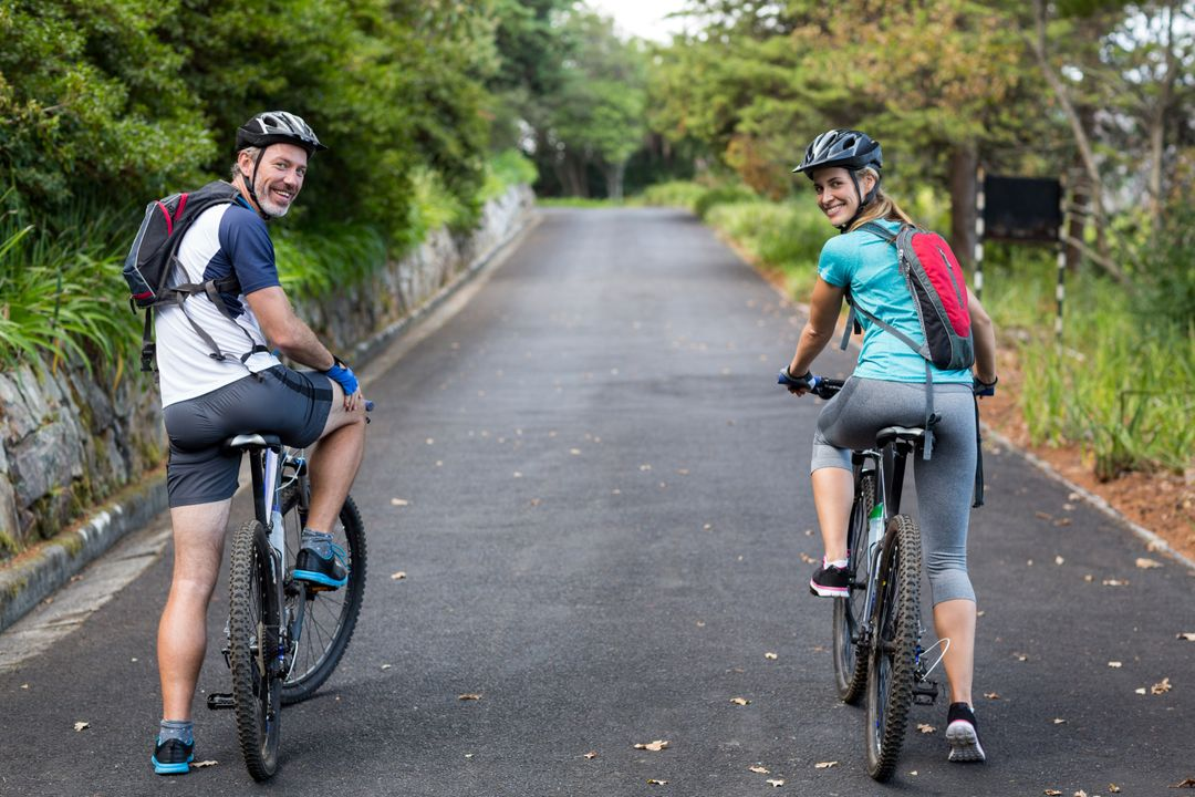 Smiling athletic couple cycling on the open road Free Stock Images from PikWizard