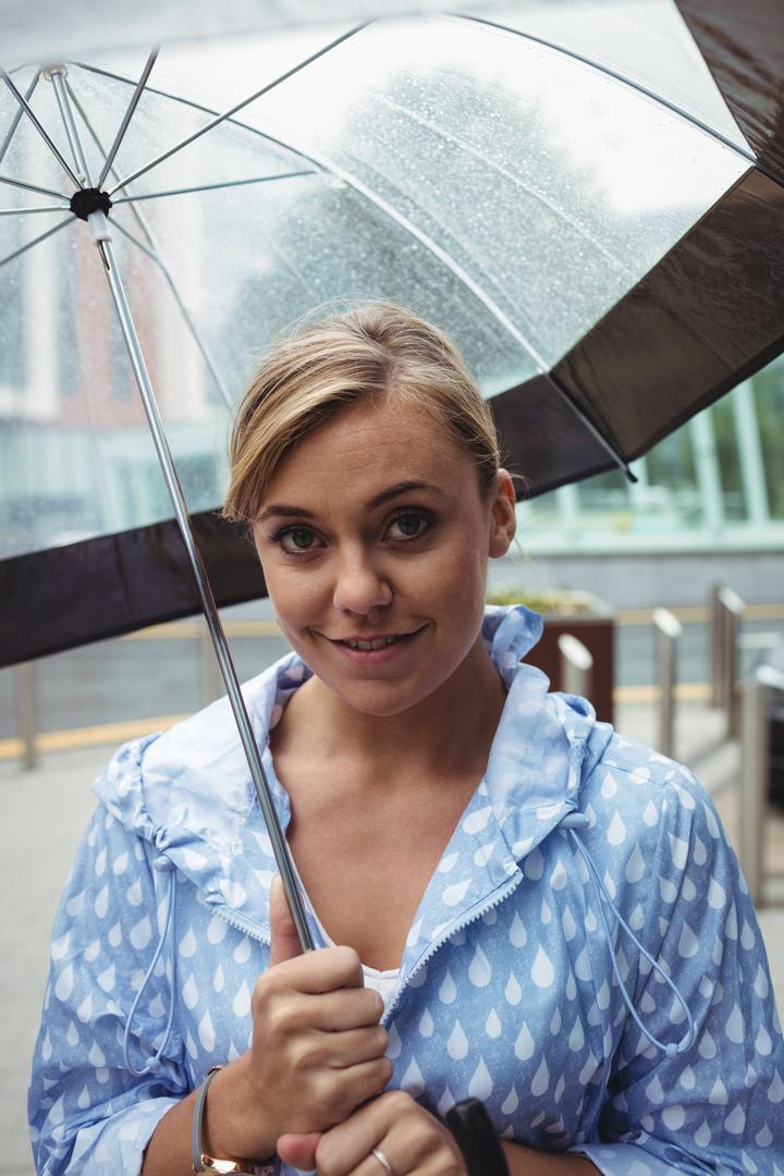 Portrait of beautiful woman holding umbrella during rainy season Free Stock Images from PikWizard