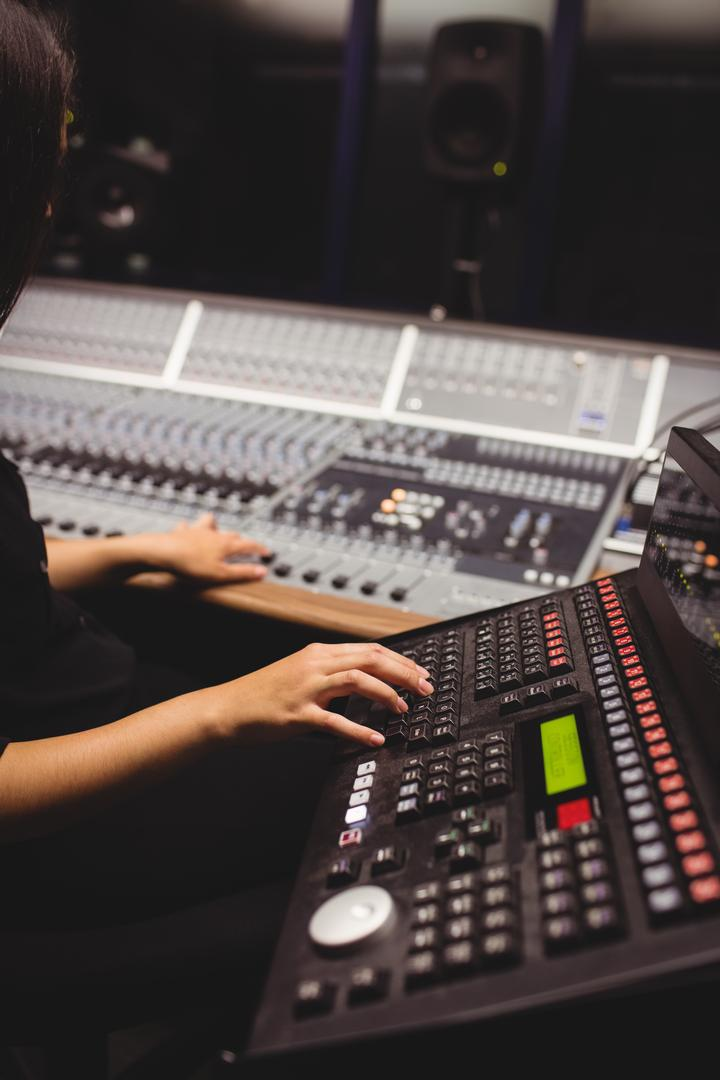 Female student using sound mixer keyboard in a studio Free Stock Images from PikWizard