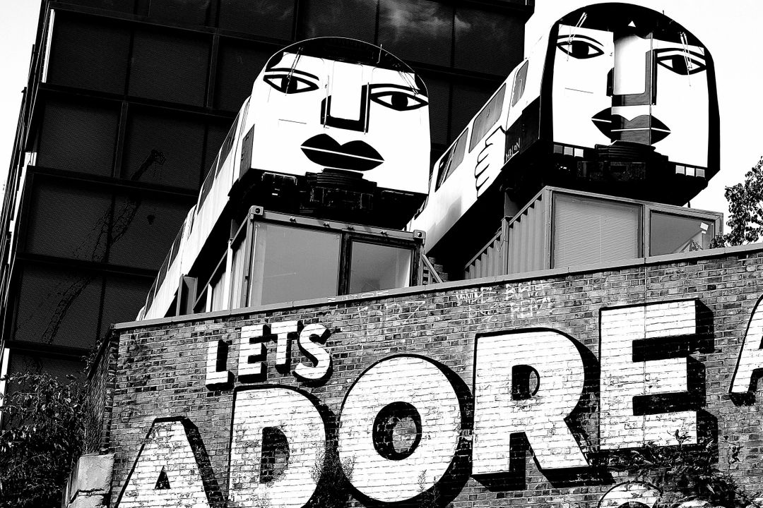 Graffiti sayings 'Let's Adore' on a building
