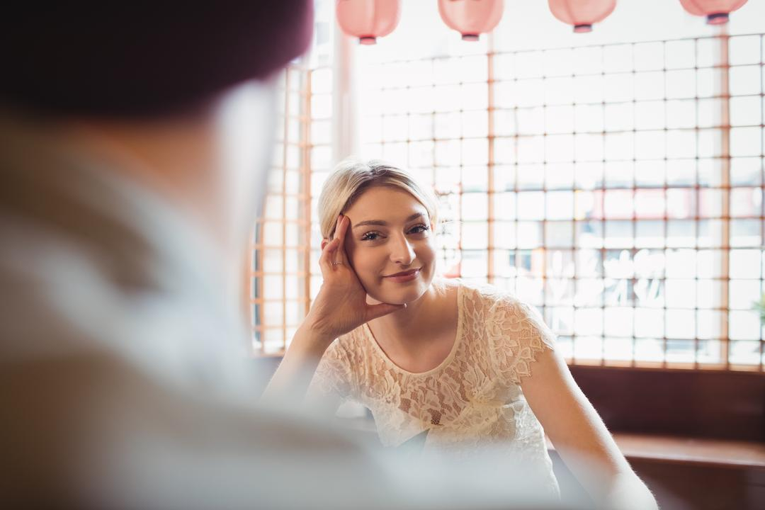 Beautiful woman looking at man in restaurant