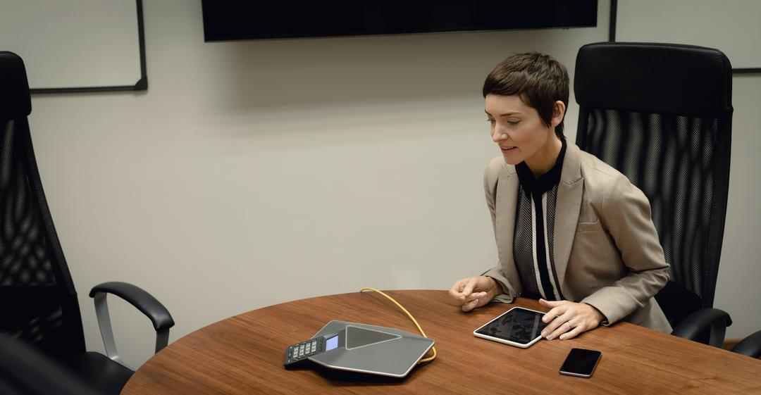 Businesswoman talking on conference call in office