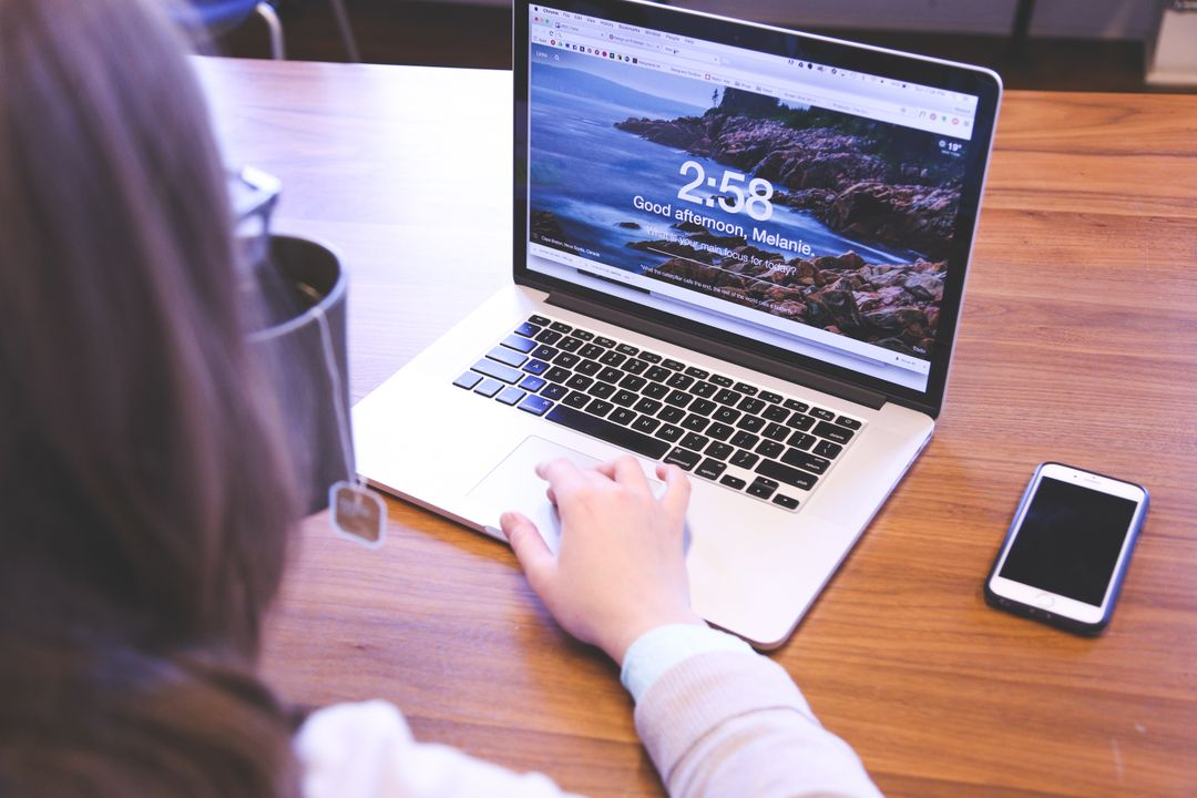 Image of a Woman Using her Laptop Taken from Behind