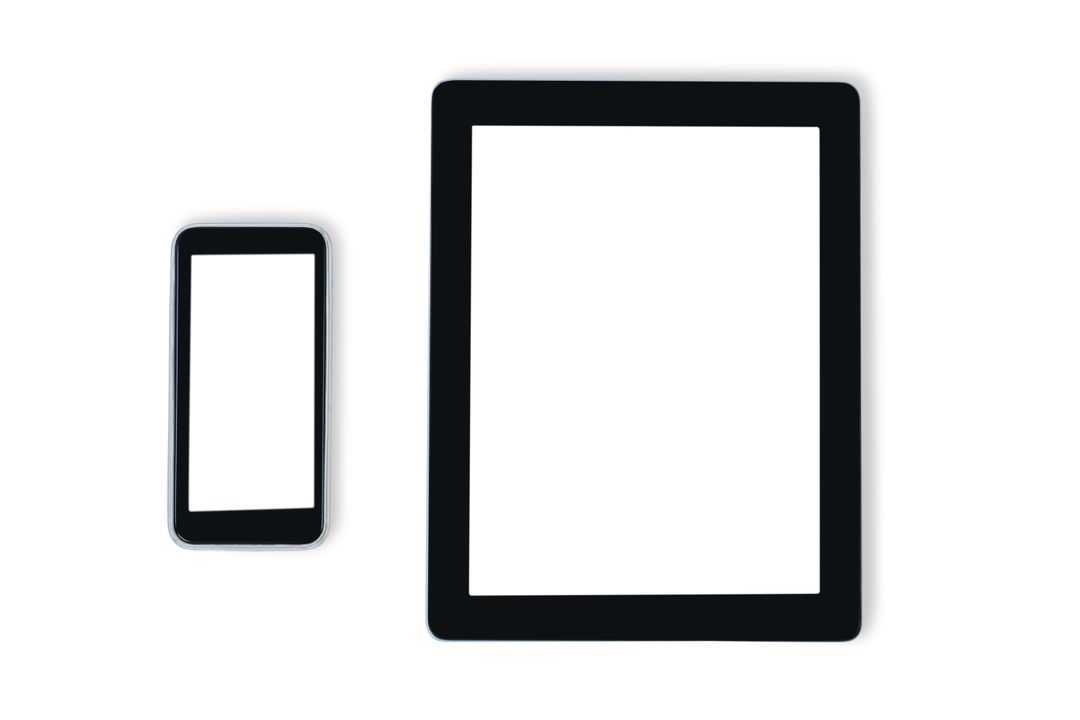 Close-up of mobile phone and digital tablet against white background Free Stock Images from PikWizard