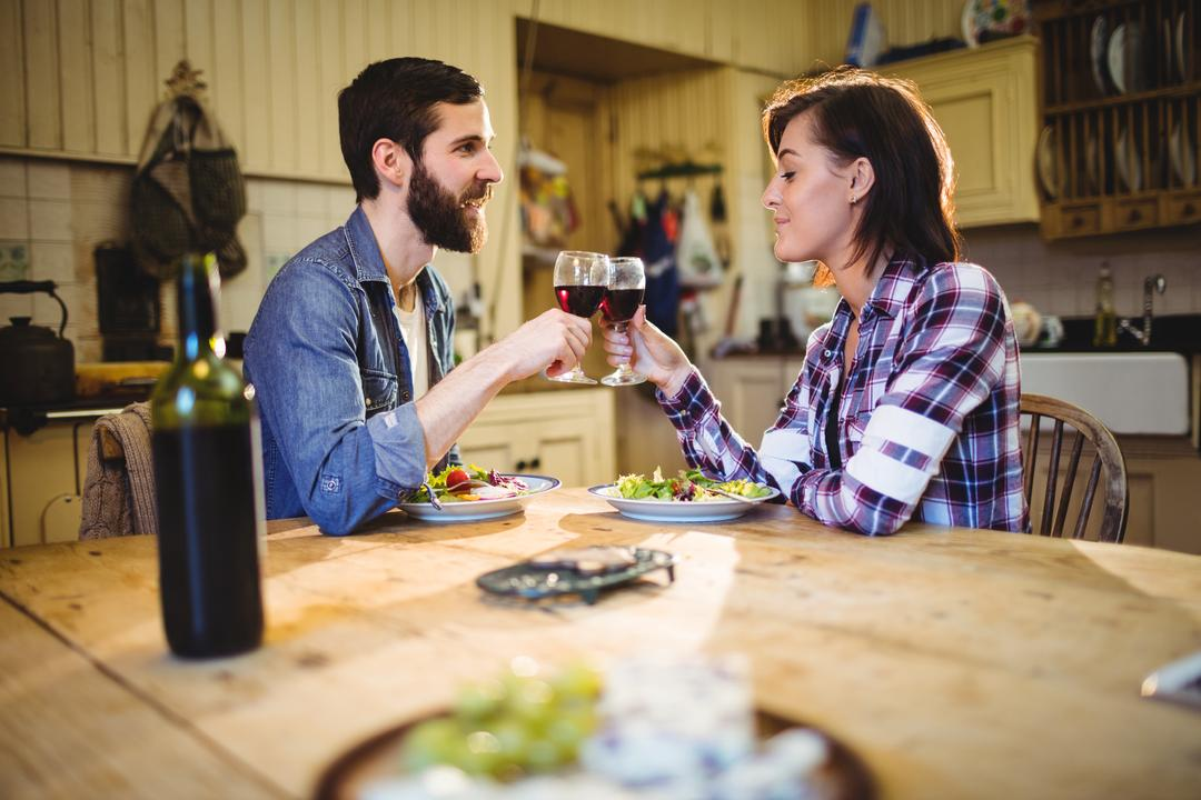 Couple having wine and breakfast at home
