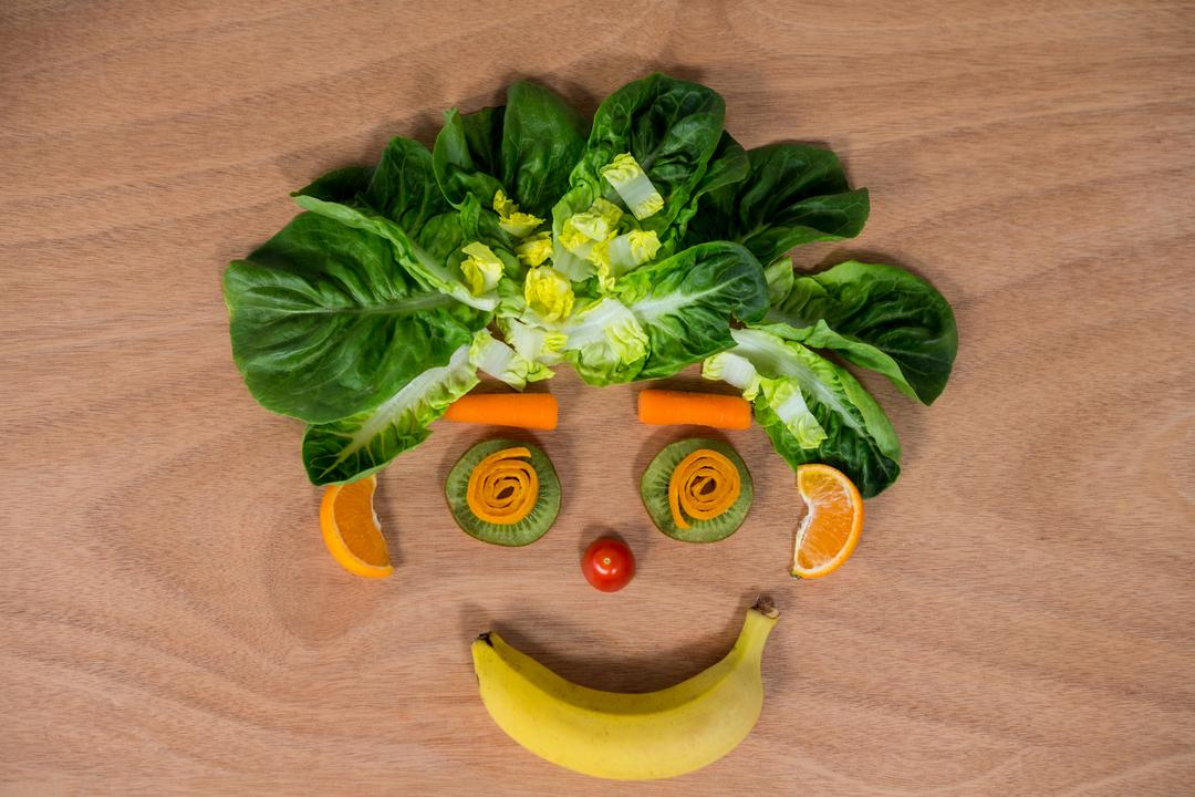 Smiley face made of fruits and vegetables on wooden table Free Stock Images from PikWizard