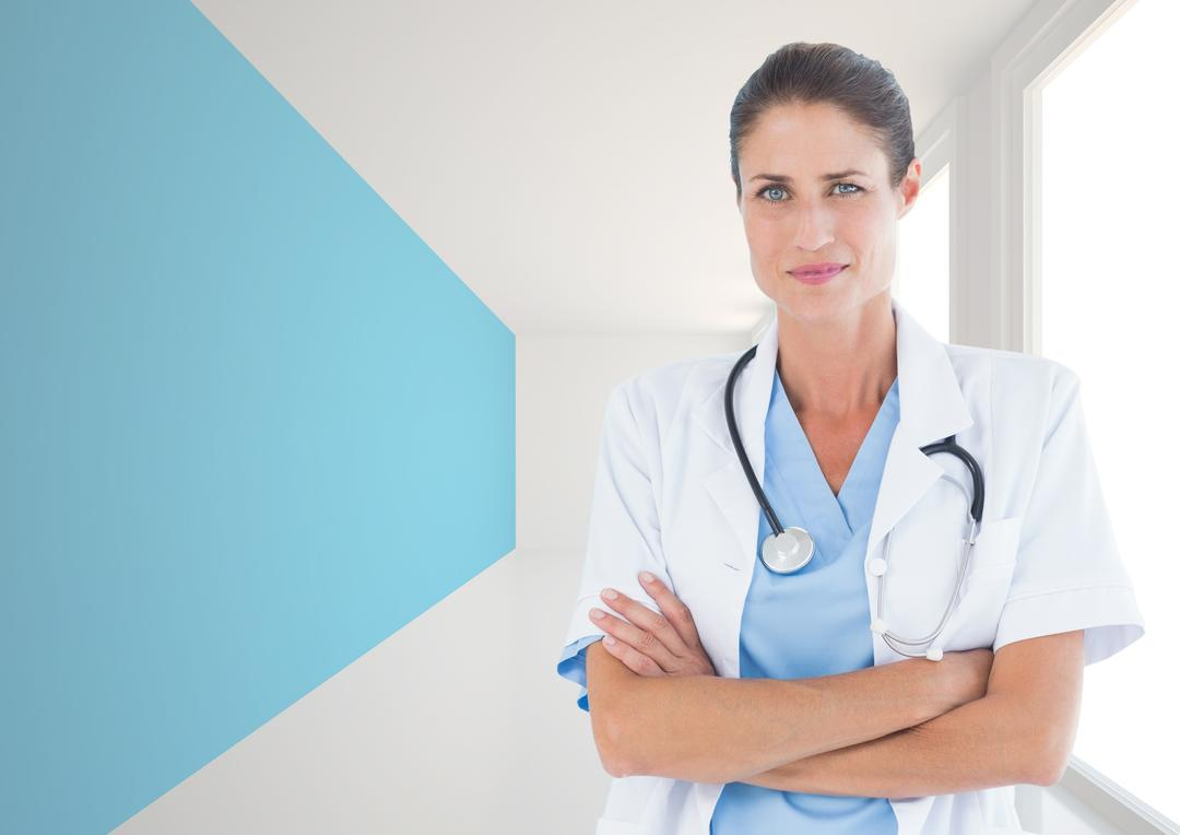 Portrait of doctor standing with arms crossed in hallway Free Stock Images from PikWizard