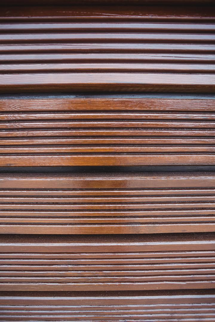 Wooden panels with striped pattern background, full frame