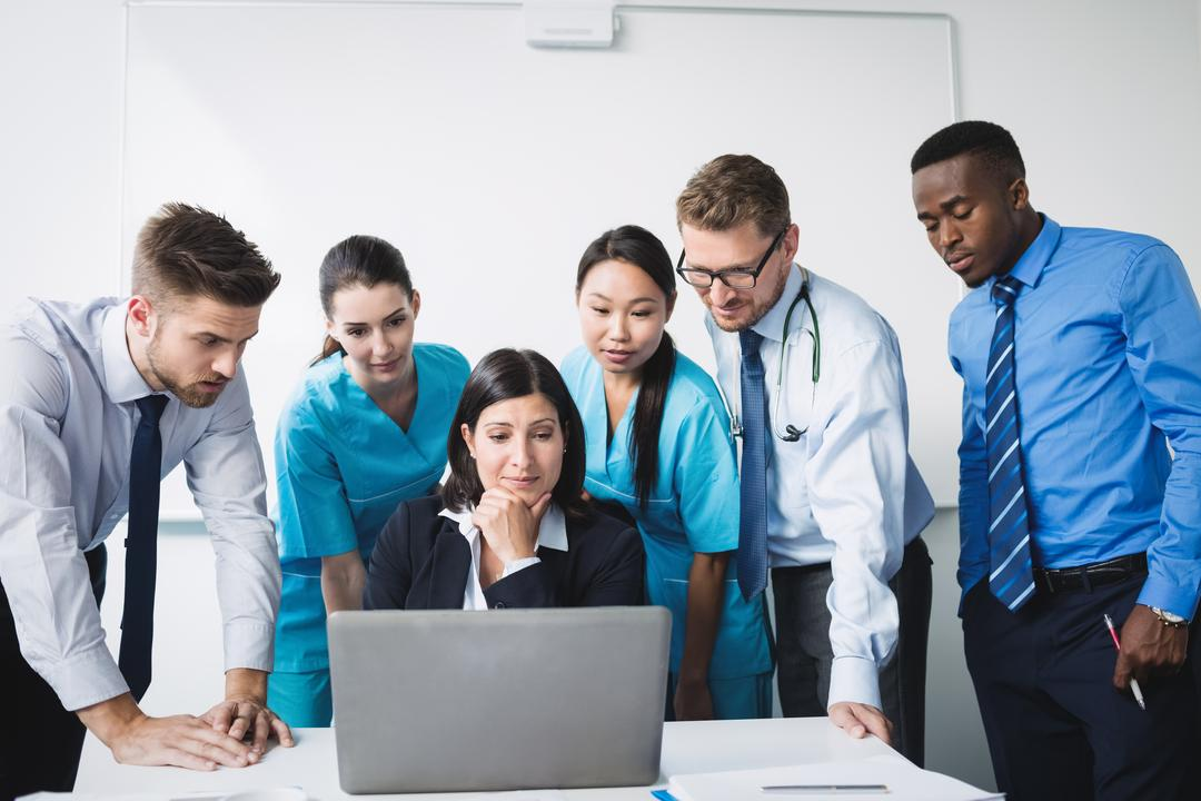 Team of doctor discussing over laptop in meeting at conference room