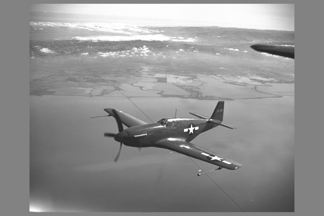 North American P-51B 'Mustang' fighter in flight over bay area. The P-51 with its new laminar-flow wing sections developed by NACA was the first airplane selected for testing of airplane drag in flight and wind tunnel comparison  NOTE: used in NASA Publication; Flight Research at Ames: 57 Years of Development and Validation of Aeronautical Technology' Transonic Model Testing fig. 9 NASA SP-1998-3300
