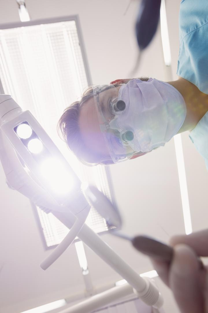 Close-up of dentist holding dental tools at dental clinic