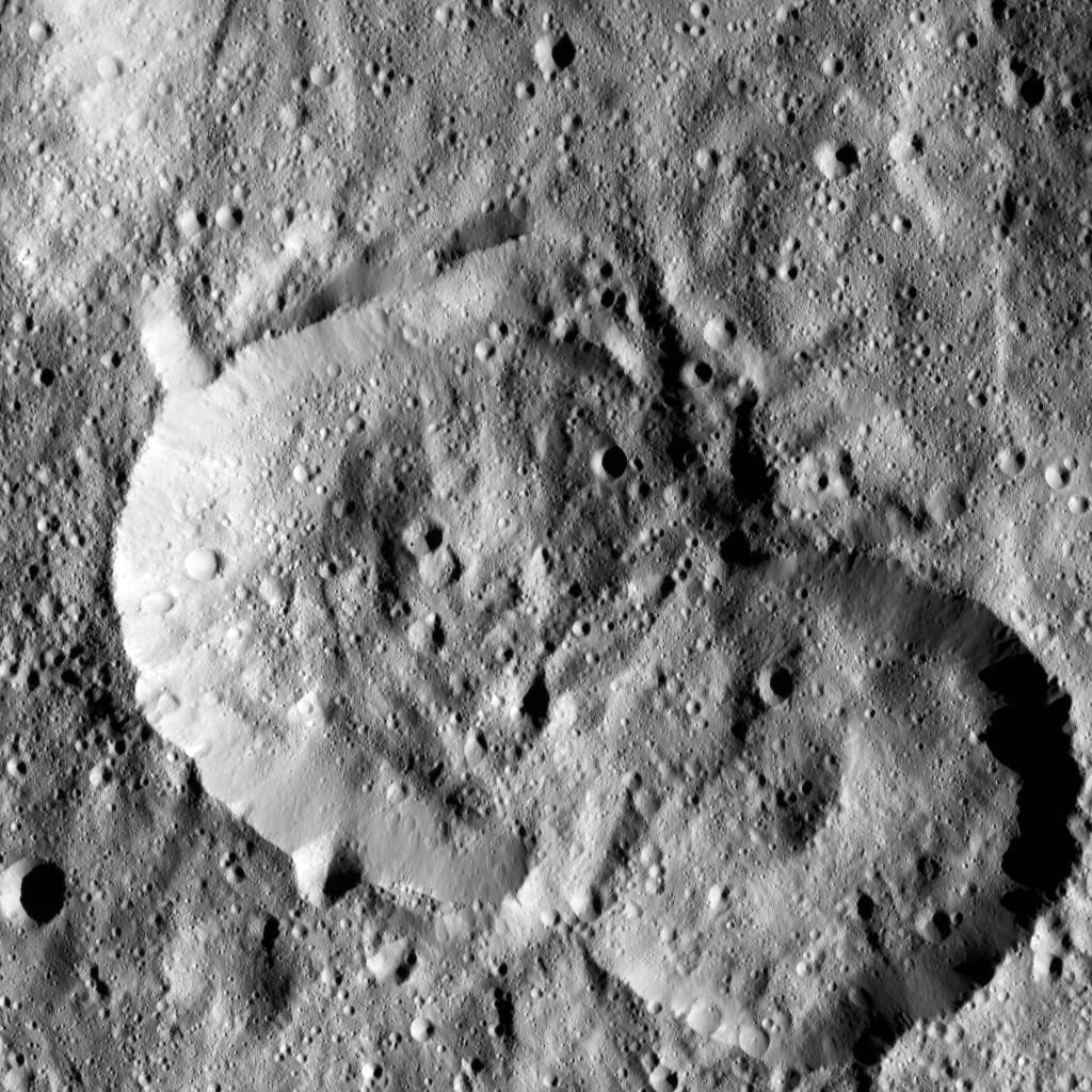 NASA Dawn spacecraft spotted this pair of craters on Ceres on January 25, 2016. The crater at left is named Jaja, after the Abkhazian harvest goddess. Jaja Crater is 13 miles 21 kilometers in diameter and is located in the northern hemisphere.