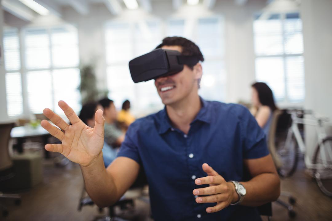 Man using virtual reality headset in the office Free Stock Images from PikWizard