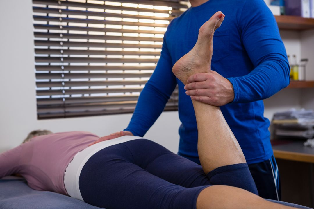 Physiotherapist giving leg massage to a woman in clinic Free Stock Images from PikWizard