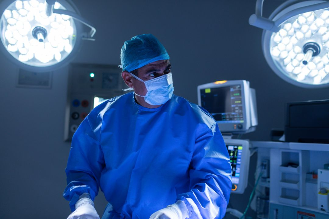 Front view of male surgeon performing operation in operating room at hospital