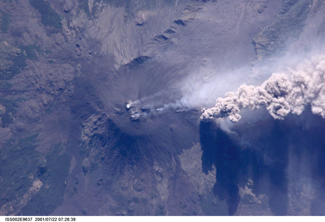 ISS002-E-9637 (22 July 2001) --- An overhead look at the smoke and ash being expelled from the erupting volcano Mt. Etna on the island of Sicily.  This image was recorded by an Expedition Two crew member with a digital still camera.