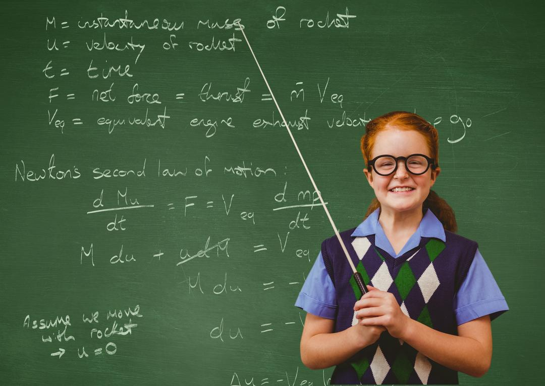 Digital composition of a smiling girl standing in front of chalkboard in classroom