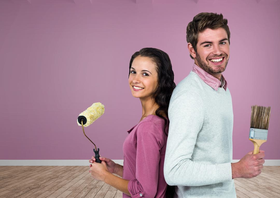 Digital composite of Couple with paintbrush and roller in room