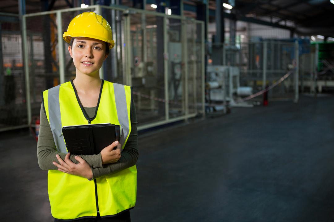 Portrait of beautiful young woman holding digital tablet in warehouse