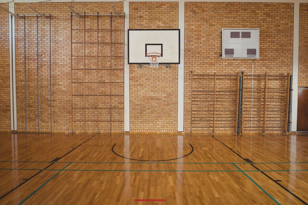 Empty basketball court in high school Free Stock Images from PikWizard