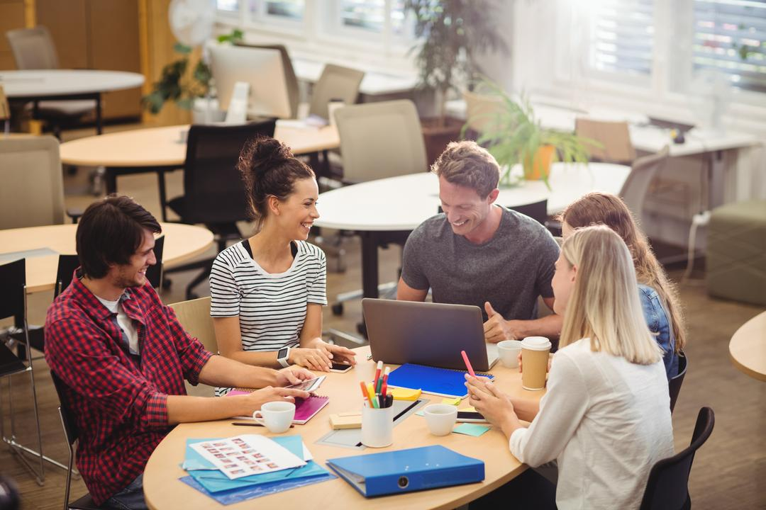 Group of people sitting at a desk working on a blog