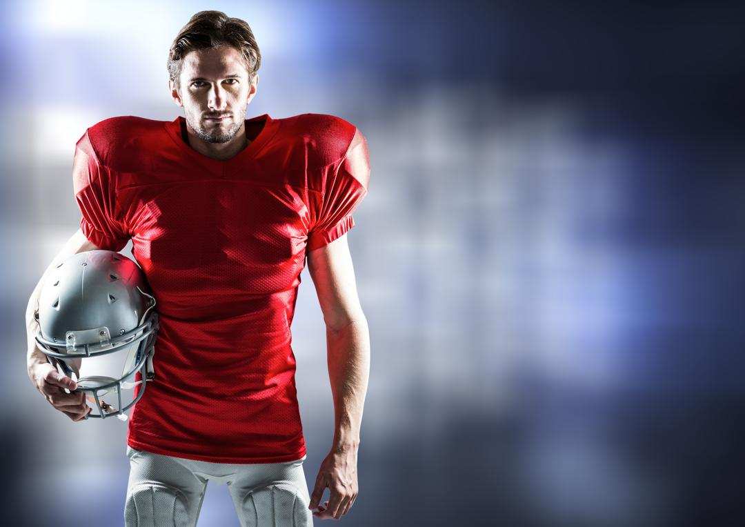 Portrait of confident american football player holding helmet Free Stock Images from PikWizard