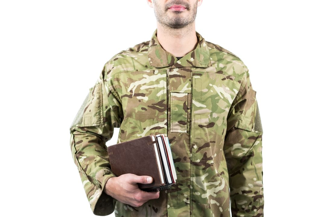 Mid section of soldier holding books against white background Free Stock Images from PikWizard
