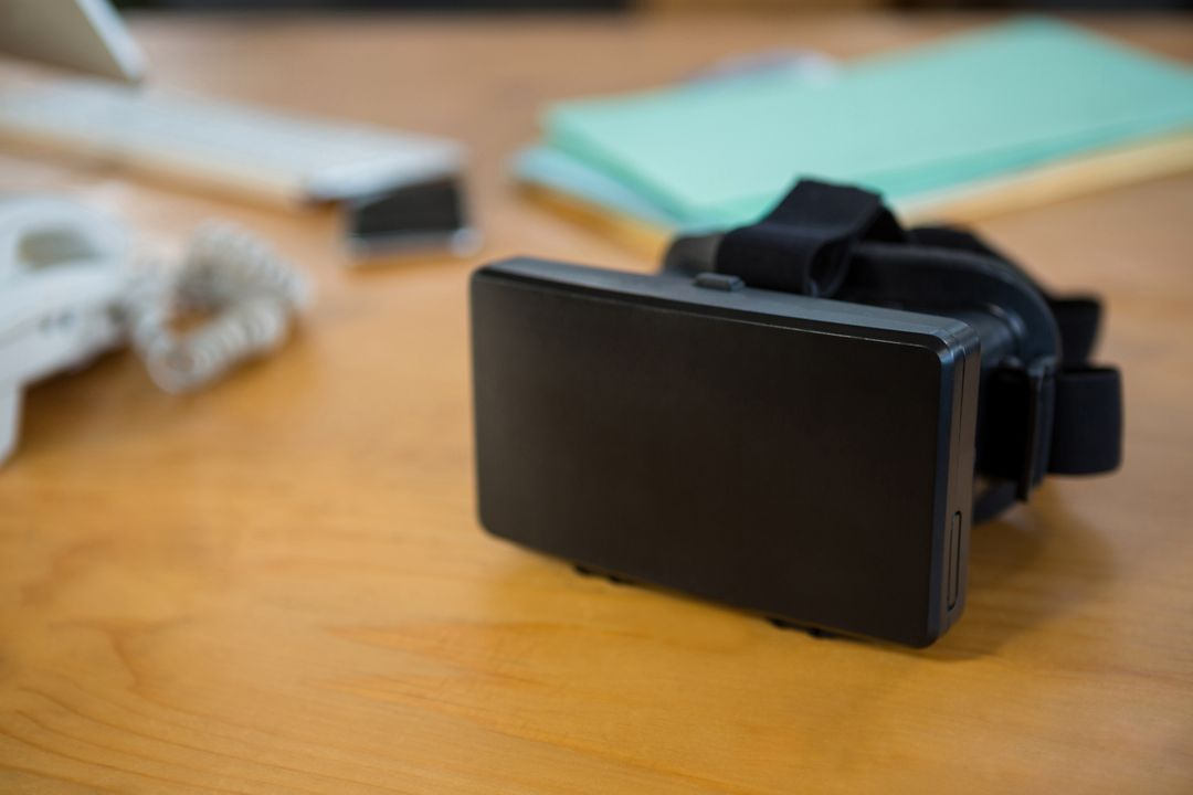Close-up of virtual reality headset on desk in office Free Stock Images from PikWizard