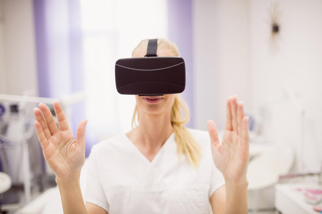 Female doctor wearing virtual reality headset