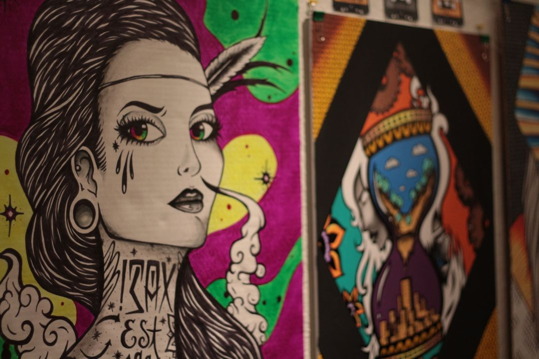 Colorful graphic designs displayed on a wall