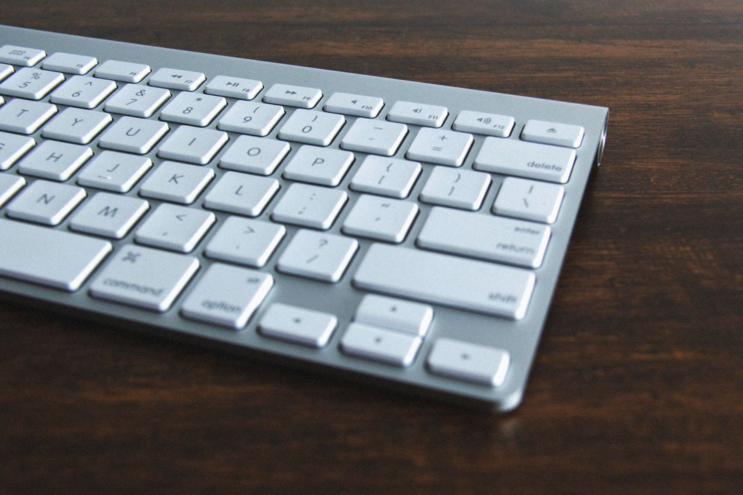 Close up image of the right hand side of a white Mac keyboard
