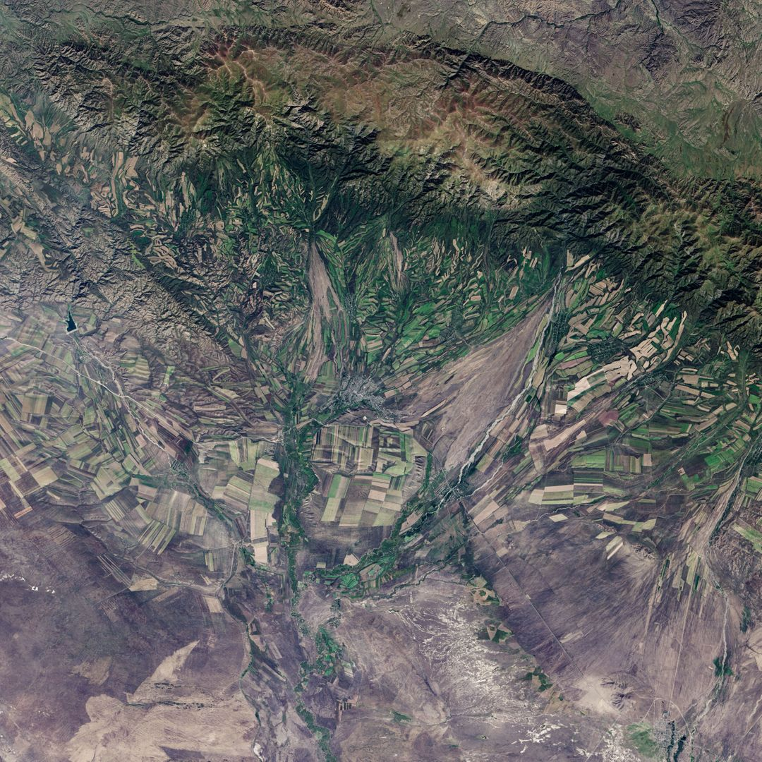 "September 22, the autumnal equinox, marks the beginning of fall in the Northern Hemisphere, but the fall harvest begins early in the harsh continental climate of eastern Kazakhstan. By September 9, 2013, when the Operational Land Imager (OLI) on the Landsat 8 satellite acquired this image, several fields were already harvested and bare. Others were dark green with pasture grasses or ripening crops. The fields fill the contours of the land, running long and narrow down mountain valleys and spreading in large squares over the plains.  Agriculture is an important segment of the economy in Kazakhstan: the country's dry climate is ideal for producing high quality wheat for export. However, 61 percent of the country's agricultural land is pasture for livestock. The area shown in this image, far eastern Kazakhstan near the Chinese border, is a minor wheat-growing region and may also produce sunflowers, barley, and other food crops.  An artifact of Soviet-era collective farms, most of the farms in Kazakhstan are large, covering more than 5,000 hectares (12,500 acres). Some of the larger fields in the image reflect the big business side of agriculture. However, family farms and small agriculture businesses account for 35 percent of the country's agricultural production, and some of these are visible as well, particularly in the uneven hills and mountains.  Nearly all agriculture in Kazakhstan is rain fed. Farmers in this region have designed their fields to take advantage of rain flowing down hills, allowing the natural shape of the land to channel water to crops. The effect is a mosaic of green and tan with tones matching the natural vegetation in the mountains to the north.  NASA Earth Observatory image by Jesse Allen using Landsat data from the U.S. Geological Survey. Caption by Holli Riebeek.  Instrument: Landsat 8 - OLI  More info: <a href=""http://1.usa.gov/16IZ047"" rel=""nofollow"">1.usa.gov/16IZ047</a>  <b><a href=""http://www.nasa.gov/audience/formedia/features/MP_Photo_Guidelines.html"" rel=""nofollow"">NASA image use policy.</a></b>  <b><a href=""http://www.nasa.gov/centers/goddard/home/index.html"" rel=""nofollow"">NASA Goddard Space Flight Center</a></b> enables NASA's mission through four scientific endeavors: Earth Science, Heliophysics, Solar System Exploration, and Astrophysics. Goddard plays a leading role in NASA's accomplishments by contributing compelling scientific knowledge to advance the Agency's mission.  <b>Follow us on <a href=""http://twitter.com/NASA_GoddardPix"" rel=""nofollow"">Twitter</a></b>  <b>Like us on <a href=""http://www.facebook.com/pages/Greenbelt-MD/NASA-Goddard/395013845897?ref=tsd"" rel=""nofollow"">Facebook</a></b>  <b>Find us on <a href=""http://instagram.com/nasagoddard?vm=grid"" rel=""nofollow"">Instagram</a></b>"
