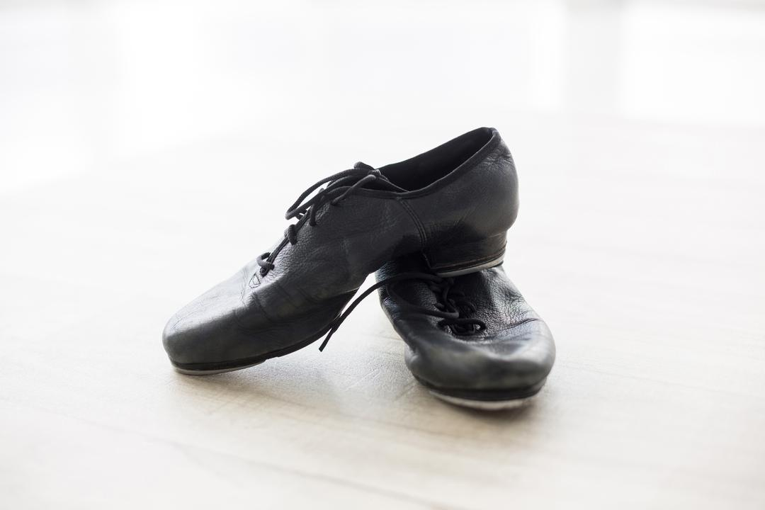 Pair of dancing shoes on wooden floor in dance studio