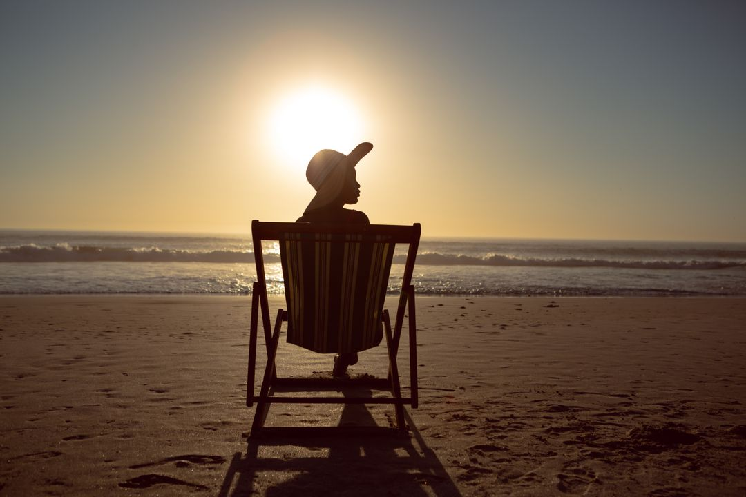 Thoughtful woman relaxing in a beach chair on the beach Free Stock Images from PikWizard