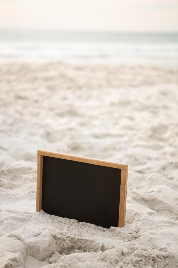 Blank slate in sand at beach Free Stock Images from PikWizard