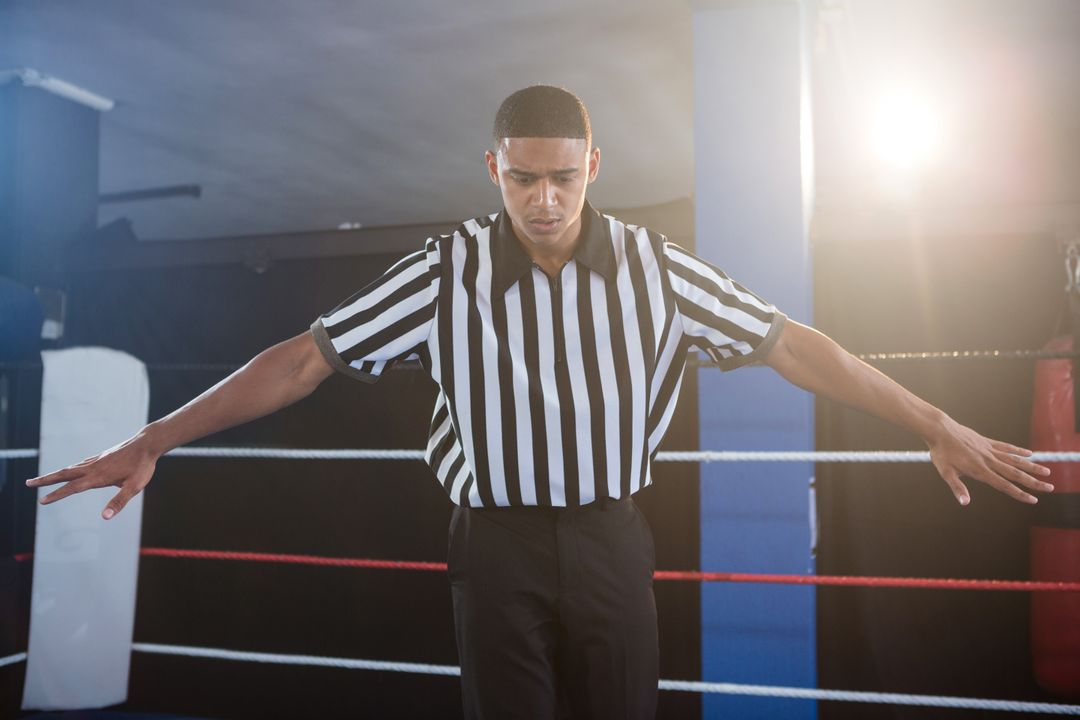 Male referee gesturing with arms outstretched in boxing ring Free Stock Images from PikWizard