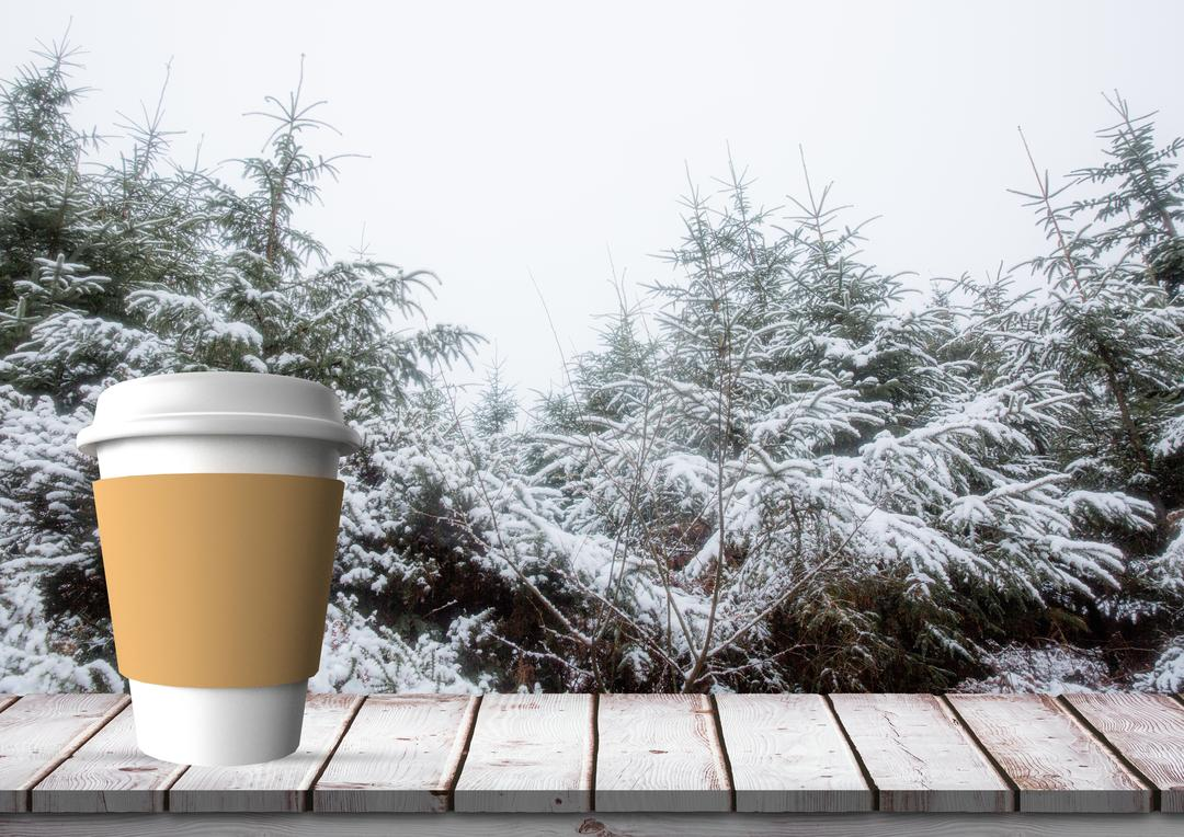 Digital composition of disposable coffee cup on wooden plank against winter forest in background