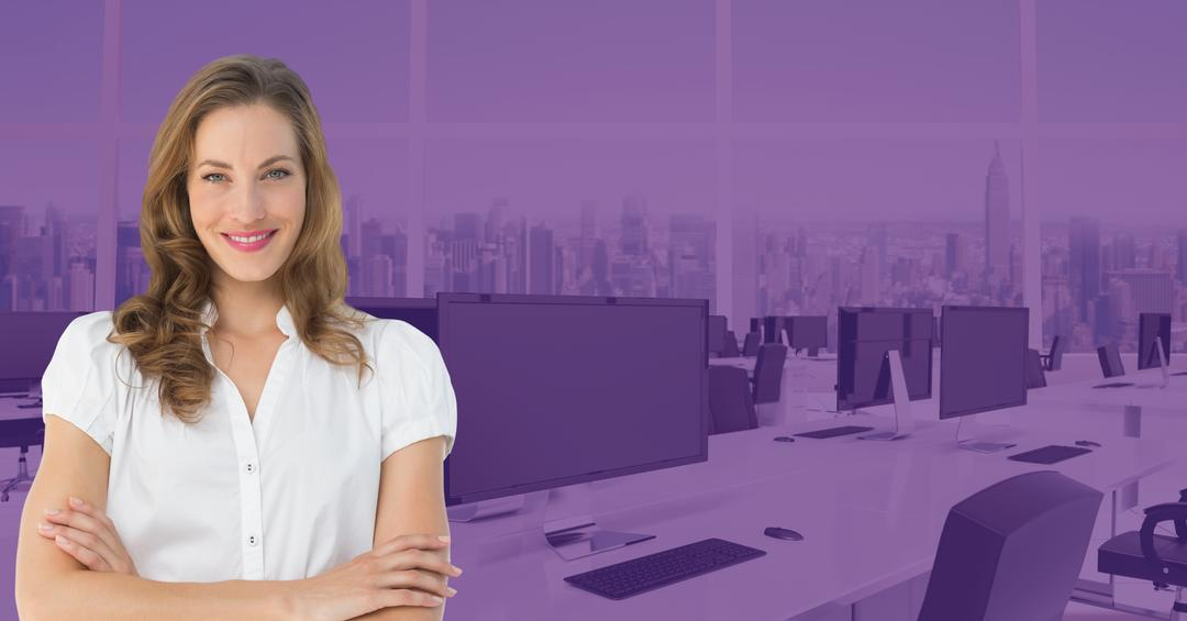Digital composition of businesswoman standing with arms crossed against office in background